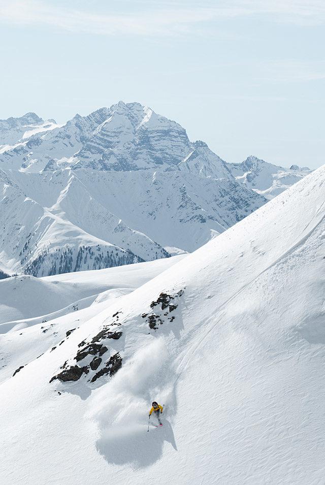Klosters, Switzerland. Men's Stellar Shell Jacket, Yellow. Men's Stellar Shell Pants, Dark Grey.